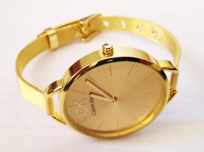 فروشگاه ساعت زنانه سی کی بند حصیری طلایی